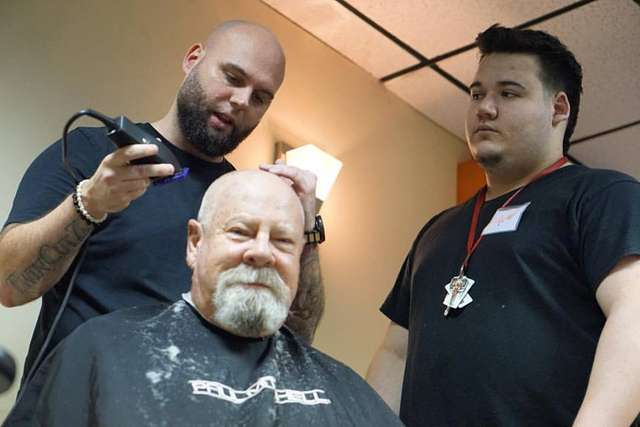 Paul Mitchell The School Fort Myers gives free haircuts to firefighters and vets on 9/11